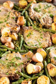 Sheet Pan Parmesan Pork Chops and Vegetables ~ Easy Parmesan Pork Chops Baked in the Oven! Roasted and Potatoes make this a great Pork Chop Meal. If you are looking for a healthy pork chop recipe you will love this one! #pork #porkchop #porkchops #sheetpan #onepan