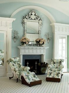 Love the mirror, sconces and mantel.