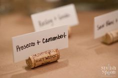 Assign seats at your next party using carved out wine corks to hold the pieces of paper.