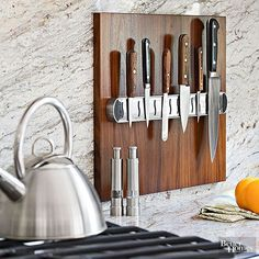 Backsplashes are storage space waiting to happen. One strategy to put this space to work for pennies: Add magnetized strips to one side of a finished board, and secure it to the backsplash to hold knives -- they're as easy to grab and use as they are to put away.