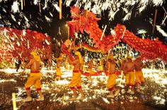 A dragon dance is performed amid fireworks during a Lantern Festival celebration in Chongqing municipality, on February 6, 2012.