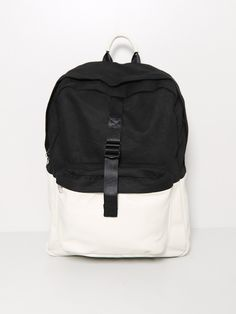 "combo leather backpack - Combo Leather backpack in black/white by Oak  Features  • Black canvas upper and adjustable straps  • White leather body, straps and handle  • Smaller front center pouch  • Silver tone metal hardware  Composition  Canvas and leather combo  Made in U.S.A.  H: 18"" W: 14"" D: 5.5"""