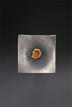 Contemporary and elegant brooches by Seattle Jeweler Andy Cooperman in a variety of metals and materials.