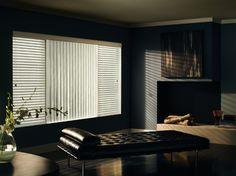 For a modern look, consider mixing vertical and horizontal designer blinds. ShutterLuxe can help you customize a look just for you.