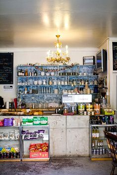 Hurwundeki Cafe | London love the color pop of the blue storage