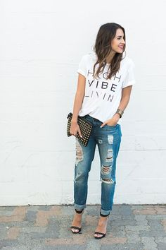 Graphic t-shirt, boyfriend jeans, barely there heels, studded clutch and bright lipstick.: