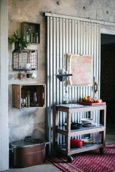Love the incorporation of corrugated iron metal with this sliding door feature / Industrial / Refashioned Style