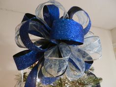 Ordering this for my topper to my new blue/white Christmas tree! Love the colors!! made by creativelycarole.