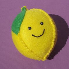 lemon plush hand stitched vegan felt play food or kitchen collectible with smiley face. $14.00, via Etsy.