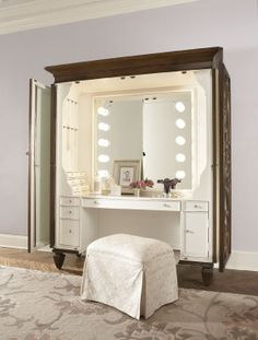 Jessica McClintock Couture - This Dressing Armoire brings both an elegant style and functionality in your room. Behind its two delicately designed doors lies a fully equipped vanity which is great  for organizing jewelry and various essentials in its 12 small jewelry drawers, 16 jewelry pegs, 4 larger drawers with felt bottoms, 1 drawer with a jewelry tray, and one adjustable shelf behind a small door. #AmericanDrew #JessicaMcClintock #MakeupStation