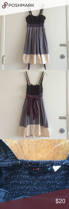 """Lux tie back cotton dress Flirty and fun 100% cotton dress with side zip, elastic panel in back, and tie in back waist. Just  over 18"""" from the bottom of the waistband to hem. Great used condition, there are just creases on the tie and some light fading on the waistband. Urban Outfitters Dresses"""