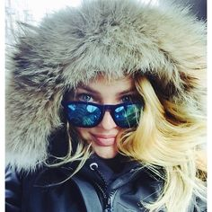 Candice Swanepoel bundles up in a winter coat