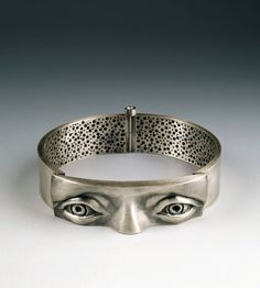 Soyoung Park  Observing Obsession  sterling silver.   made by repousse and chasing techniques.