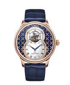 GRANDE SECONDE TOURBILLON   Paillonné dial in blue Grand Feu enamel.  18-carat red gold case.  Self-winding tourbillon movement.  Power reserve of 7 days.  Diameter 43 mm.  Numerus Clausus of 8.