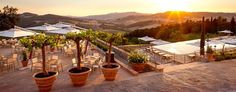 A glorious and versatile terrace bathed in the Tuscan sun that overlooks the pool to the patchwork of vineyards that ascend to the charming town of Casole d'Elsa.