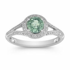 "Round Green Sapphire and Diamond Ring (Shane Co.) (""This stunning vintage inspired fashion ring focuses on one round green sapphire, at approximately .82 carat TW. This colorful gem is surrounded by 60 round, pavé-set diamonds, at approximately .15 carat TW. Crafted in quality 14 karat white gold with beautiful milgrain detailing, the total gem weight is approximately .97 carat."")"