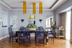 Colonial Glam in Manila chippendale chairs w purple cushions, table w brass accents, mirror inset into moulding