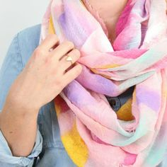 We're always looking for fun ways to add a pop of color to our winter wardrobe! This DIY scarf is both fun and fashionable!