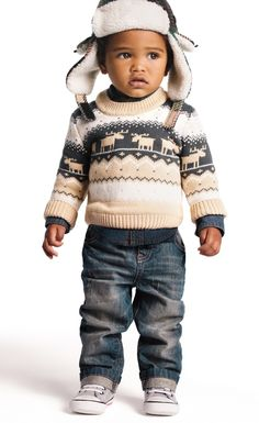 The only thing cuter than a little kid is a little kid bundled up in holiday gear.