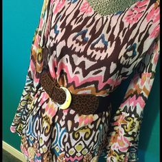 NWT tunic top Gorgeous v neck tunic top with bell sleeves.  Pink, brown, turquoise, gold and cream.  100 polyester. Fully lined in fuchsia.  So cute belted with skinnies and boots . Tops Tunics