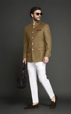 This Columbia Brown Jodhpuri Suit Jacket is tailored from Super Italian wool fabric and the white pants are made out of Italian milled long-staple cotton fabric. Mens Wedding Wear Indian, Mens Indian Wear, Mens Ethnic Wear, Wedding Dresses Men Indian, Wedding Dress Men, Indian Men Fashion, Mens Fashion Suits, Wedding Men, Wedding Suits