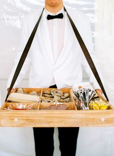 Roaming oyster and seafood bar for the wedding cocktail hour | Photo: Jodi Miller Photography