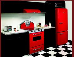 ummm...yea. I love a red and black kitchen. I guess I need to think about remodeling my kitchen. lol. But this is definitely the kitchen I want.