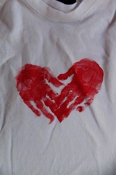 Heart Handprint T-shirts for Valentine's Day --I should have my babies make these hearts on the belly of my shirt to show their love for their brother to be