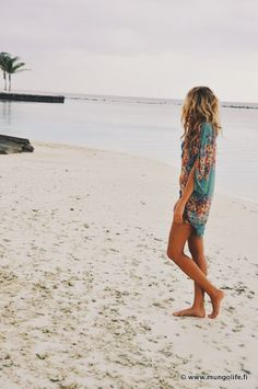 Awesome shot. Love the coverup & her beach hair.