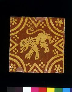Inlaid tiles of this type were produced in Artois and the Flanders region of Belgium during the 18th century.
