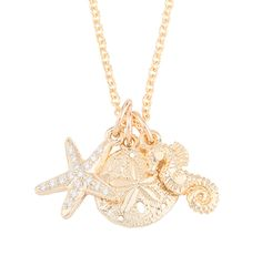 Beach Treasures: Summer inspired yellow gold charm necklace features the Pave Starfish Mini Charm, the Sand Dollar Mini Charm and the Seahorse Mini Charm.
