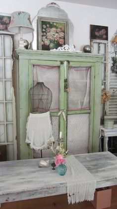 Love the green cabinet - and would put this in my YARN storage area of my fibers studio - lo9aded with luscious YARNS.