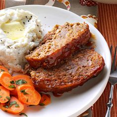 Best-Ever Meat Loaf Recipe -The combination of onion, carrots, parsley and cheese—plus the tomato-mustard topping—makes this meat loaf really colorful. The recipe lends itself easily to being doubled or halved to suit the number you're cooking for, and it freezes well, too. —Anna Baker, Blaine, Washington