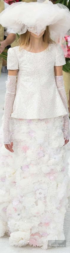 Chanel.Spring 2015 Couture. Poor little model. how funny was her walk! the dress must have weighed twice as much as her. chanel.com