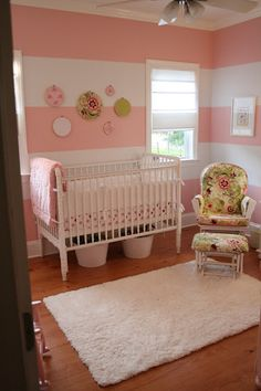 Baby girl nursery via Popsicles & Paint. I LOVE the fabric against the stripes!