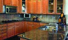 Love the quartz countertops and maple cabinets! Black Granite Countertops, Granite Kitchen, Kitchen Backsplash, Dark Granite, Backsplash Ideas, Black Counters, Kitchen Counters, Kitchen Cabinets, Black Kitchens
