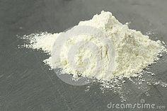Wheat flour heap on black surface