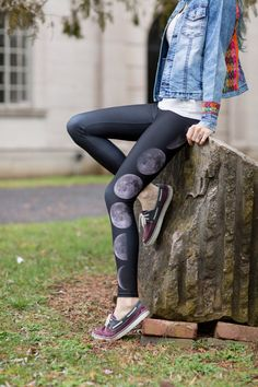 Black yoga pants with realistic moon phases down side of one leg. Moon phase leggings designed by Wander Knot.