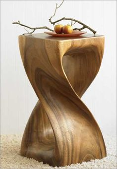 A twisted stool or side table . Monkey Pod wood which I have never heard of. But its a fantastic piece of furniture .