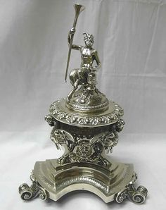 A magnificent 19th century Roman covered spice box or ink stand. A highly decorative piece with a bacchanalian figure to the lid and mythical winged creatures supporting the font.
