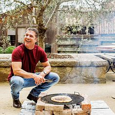 Go hands on with celeb chef Michael Chiarello, who shows us how to build a firepit fast and grill great food