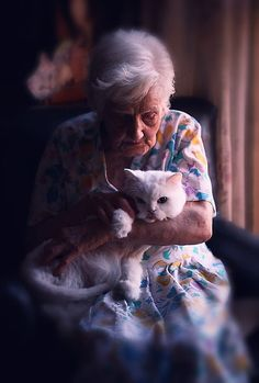 Mary with her cat......very sweet . . pets are great company as we get older . . . they're definitely FAMILY . .
