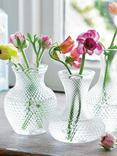 These vases look sweet when grouped and only require a few flowers each to make a statement.