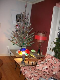vintage Christmas - aluminum tree! The Enterlines had one of these. I thought it was so elegant! With the colored lights turning and shining on the branches.