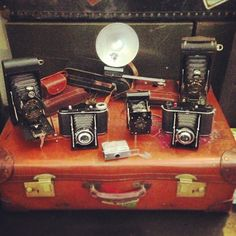 Collection of antique and vintage cameras ready to go on sale.