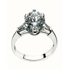 platinum engagement ring with a round brilliant cut diamond ctsand two baguette cut diamonds where to purchase bvlgari