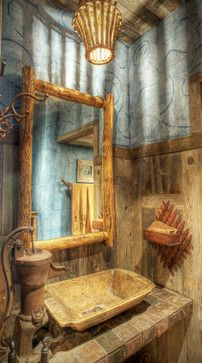 This beautiful rustic bathroom by Rockport Architects & Building Designers and Maison et Jardin LLC uses an old wooden bowl as a sink.