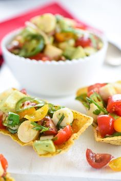 Tomato & Hearts of Palm Salad - A bright and fresh salad of tomatoes, hearts of palm and avocado, tossed with a lime-paprika dressing.   foxeslovelemons.com