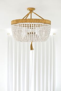 As I mentioned in Tuesday's post, on Monday I finally had all of my light fixtures installed! I don't mean to sound obnoxious, but it's actually crazy how much decorative. Transitional Living Rooms, Transitional House, Ro Sham Beaux, Low Ceiling Lighting, Beaded Chandelier, Chandeliers, Luxury Lighting, Minimalist Interior, Design Your Own