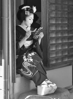 Geisha's shoes, making even the act of walking a work of art. Not an easy thing to master